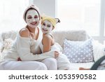 mom with her daughter making... | Shutterstock . vector #1053590582