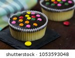vanilla cupcakes with chocolate ... | Shutterstock . vector #1053593048