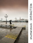 Small photo of view to San Giorgio Maggiore Venice during the high tide, or aqua alta, that flooded the square with sea water