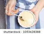 woman holding bowl with vanilla ... | Shutterstock . vector #1053628388