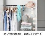 women clothing on hangers in... | Shutterstock . vector #1053644945