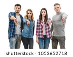 the four people thumb down on... | Shutterstock . vector #1053652718