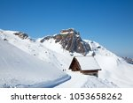 winter in the swiss alps ... | Shutterstock . vector #1053658262