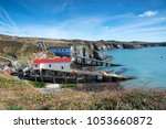 boat houses at st justinian... | Shutterstock . vector #1053660872