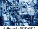 modern automobile production... | Shutterstock . vector #1053664052