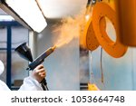 powder coating of metal parts.... | Shutterstock . vector #1053664748