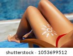 young woman with sun shape on... | Shutterstock . vector #1053699512