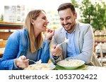 happy couple is enjoying pasta...   Shutterstock . vector #1053702422