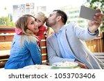 happy family is enjoying pasta...   Shutterstock . vector #1053703406