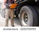 truck driver holding clipboard... | Shutterstock . vector #1053705995