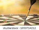 target dart with arrow  center... | Shutterstock . vector #1053714212
