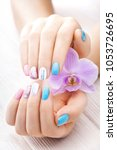 beautiful colored manicure with ...   Shutterstock . vector #1053726695
