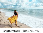 girl wearing floral maxi skirt... | Shutterstock . vector #1053733742