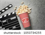 clapperboard and popcorn on... | Shutterstock . vector #1053734255
