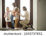 caring parents helping happy... | Shutterstock . vector #1053737852