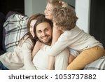 smiling man looking at camera... | Shutterstock . vector #1053737882