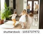 rear view at kids running to... | Shutterstock . vector #1053737972