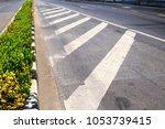 road marking lines on asphalt... | Shutterstock . vector #1053739415