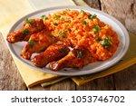 porcion of african jollof rice... | Shutterstock . vector #1053746702