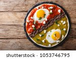 mexican breakfast  eggs huevos... | Shutterstock . vector #1053746795