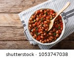 stewed cranberry beans or... | Shutterstock . vector #1053747038