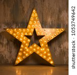 large wooden star with a large... | Shutterstock . vector #1053749642