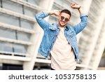 fashion guy posing in... | Shutterstock . vector #1053758135