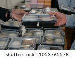 lunch box for audience... | Shutterstock . vector #1053765578