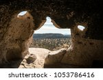 cave dwelling at tsankawi trail ... | Shutterstock . vector #1053786416