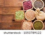 various cereals  seeds  beans... | Shutterstock . vector #1053789122