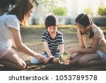 cute asian children and mother... | Shutterstock . vector #1053789578