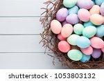 pastel easter eggs background.... | Shutterstock . vector #1053803132