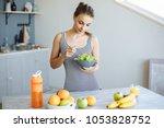 portrait of a happy girl having ... | Shutterstock . vector #1053828752