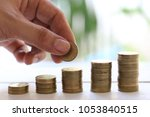 coins stack in business graph... | Shutterstock . vector #1053840515