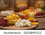 cheese plate with fruits and... | Shutterstock . vector #1053849212