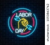 glowing neon labor day sign in...   Shutterstock .eps vector #1053863762