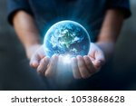 earth day  human hands holding... | Shutterstock . vector #1053868628
