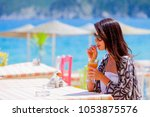 beautiful tourist woman... | Shutterstock . vector #1053875576