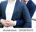 closeup of two men in suits... | Shutterstock . vector #1053878195