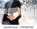 businessman holding touchscreen | Shutterstock . vector #105389306
