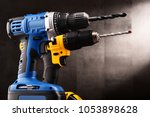 Two cordless drills with drill bits working also as screw guns. - stock photo