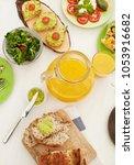 orange juice on dinner table | Shutterstock . vector #1053916682