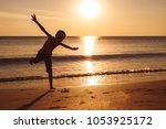 one happy little boy playing on ... | Shutterstock . vector #1053925172