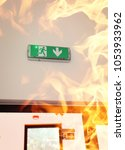 fire in the building | Shutterstock . vector #1053933962