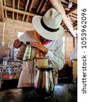 Small photo of A colombian barista preparing a fresh cup of coffee at the coffee farm in Quindio, Colombia.