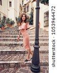 beautiful brunette young woman... | Shutterstock . vector #1053964472