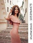 beautiful brunette young woman... | Shutterstock . vector #1053964475