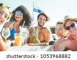 group of happy friends drinking ... | Shutterstock . vector #1053968882