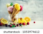 colorful ice cream balls in... | Shutterstock . vector #1053974612