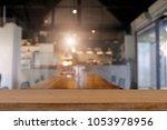 empty wooden table platform... | Shutterstock . vector #1053978956